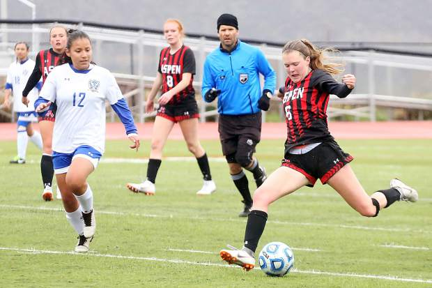 Aspen High School's Payton Curley lines up a shot in the girls soccer game against Englewood on Wednesday, May 8, 2019, on the AHS turf. (Photo by Austin Colbert/The Aspen Times)