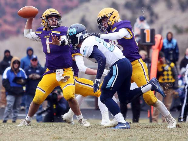 Basalt senior quarterback Trevor Reuss gets a block from senior Tai Kim while playing against Platte Valley in the 2A state quarterfinals on Saturday, Nov. 10, 2018, in Basalt. (Photo by Austin Colbert/The Aspen Times).