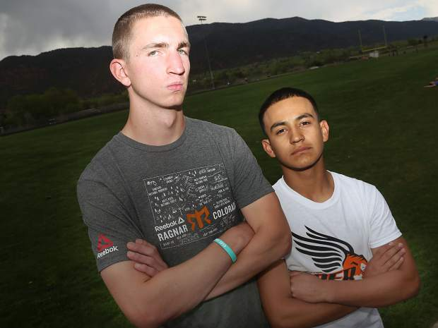 Basalt High School track and field athletes Ben Williams, left, and Rulbe Alvarado stop for a photo on Tuesday, May 14, 2019, on the BHS track. (Photo by Austin Colbert/The Aspen Times)
