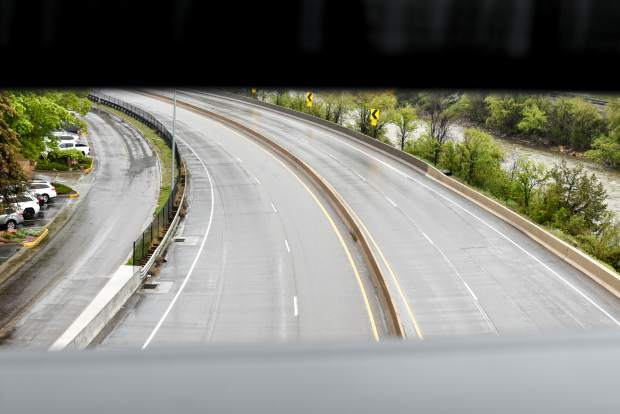 The east and westbound lanes of I-70 sit empty near downtown Glenwood after both lanes of traffic were closed early Tuesday morning due to a major rockslide in Glenwood Canyon.