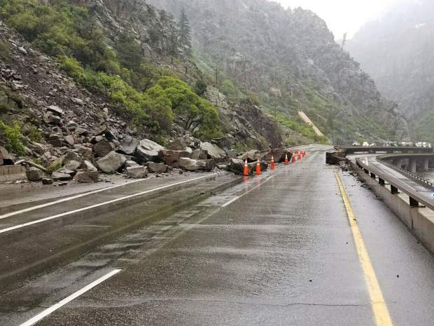 Large boulders rest near the guardrail of westbound I-70 east of Glenwood Springs Tuesday. The early morning rockslide closed the interstate for most of the day, before crews were able to clear a lane of travel.