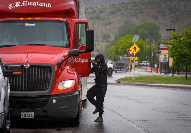 A truck driver returns to his semi while waiting in West Glenwood for I-70 to open after an early morning rockslide closed Glenwood Canyon for multiple hours.