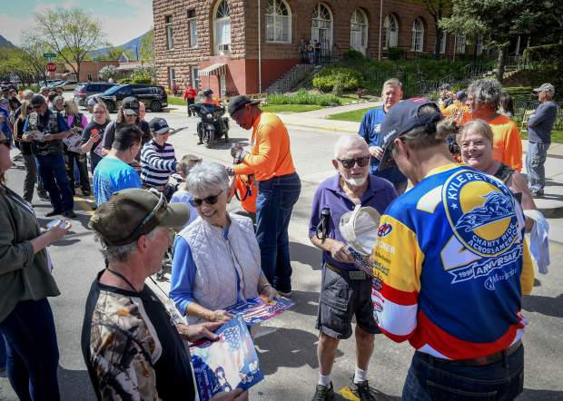 Fans line Sixth Street in front of the Hotel Colorado to get autographs from Herschel Walker, center, and Kyle Petty, right, Sunday afternoon in Glenwood Springs. Petty and his Charity Ride made a stop in the Roaring Fork Valley.