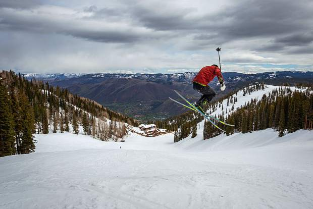 Bryce Bennet throws a stylish 360 at the top of Midnight run on Aspen Mountain Monday.