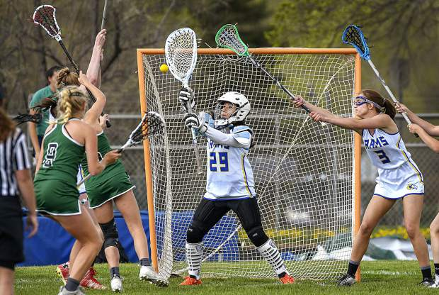Roaring Fork goalie Yahjairi Castillon can't get her stick on the shot by Conifer's Abigail Sundquist during first half action Tuesday in Carbondale. The Rams lost to the Lobos 20-9.