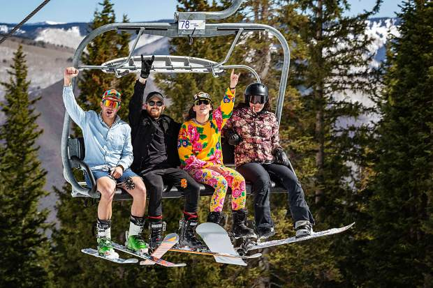 Spirits are high as skiers and boarders load the Ajax Express lift Saturday.