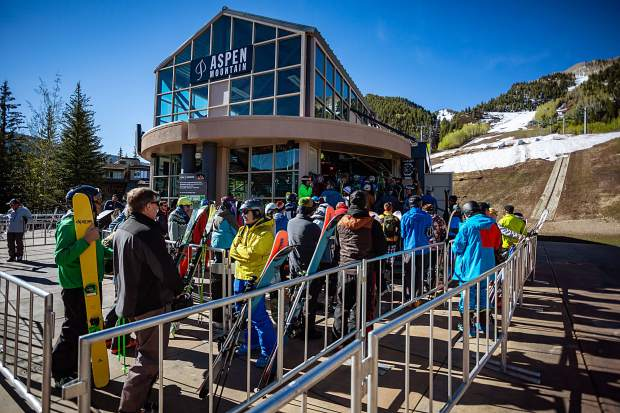 Anxious skiers and boarders fill the gondola maze as they wait for opening Saturday morning.