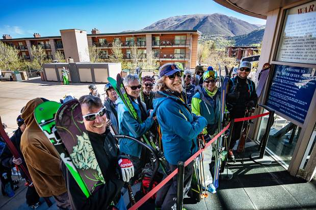 It's all smiles for locals and visitors alike waiting in line to load the Gondola Saturday morning.
