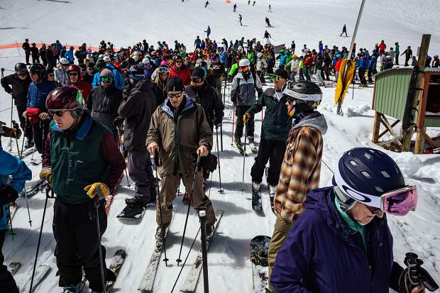 Crowds gather at the bottom of Ajax Express as the day warms up and snow softens.