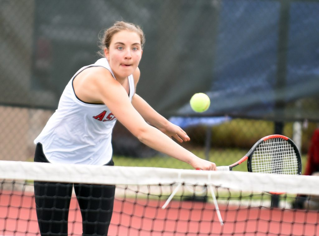 Aspen's Addy Walson focuses on the ball as she winds up her arm during the No. 1 singles match on Friday at the State 3A Tennis tournament on the Centennial Park tennis courts in Greeley.
