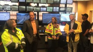 Gov. Jared Polis signs new traction, snowplow laws outside Eisenhower Tunnel