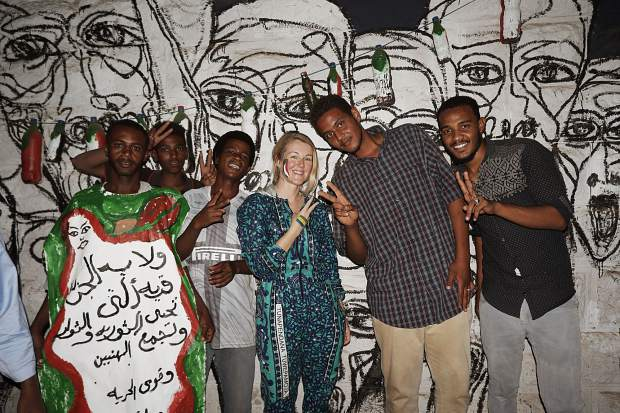 The author, center, with muralists in Khartoum, Sudan in May.