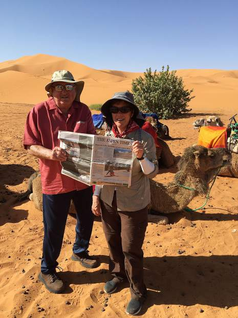Carbondale residents Uwe and Nancy Bobrow pose with a camel and a copy of The Aspen Times while on a recent trip into the Sahara Desert in Morocco with a group of 16. Email your