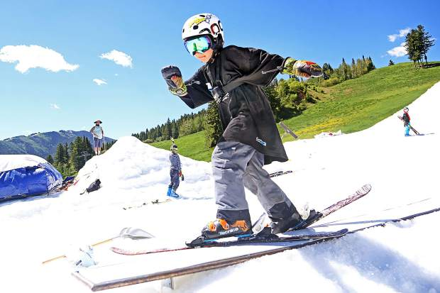 A young skier hits a rail during the 2017 AVSC Glacier Camp at Buttermilk Ski Area. (Photo by Austin Colbert/The Aspen Times).