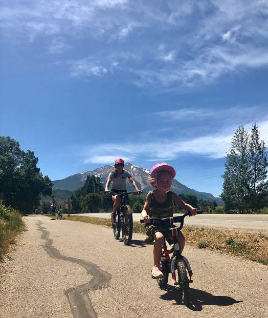 Aspen Valley Ski and Snowboard Club's Aspen Supports Kids director Meredith Elwell rides with her daughter in last year's Community Pedaleando.
