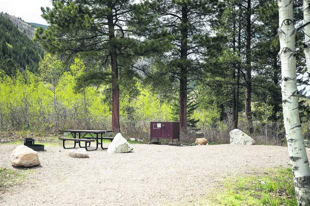 A fire ring, picnic table and bear-proof food locker are ready for campers at Difficult Campground.
