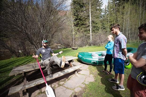 Elk Mountain Expedition guide Tom Wills gives a safety talk at the Henry Stein Park on the Roaring Fork River before running the Slaughterhouse section on May 16.