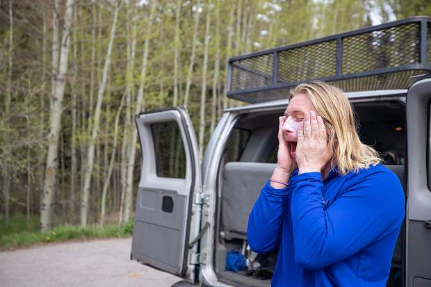 Elk Mountain Expeditions raft guide Curtis Berklund lathers sunscreen on his face before going on a trip on May 16.