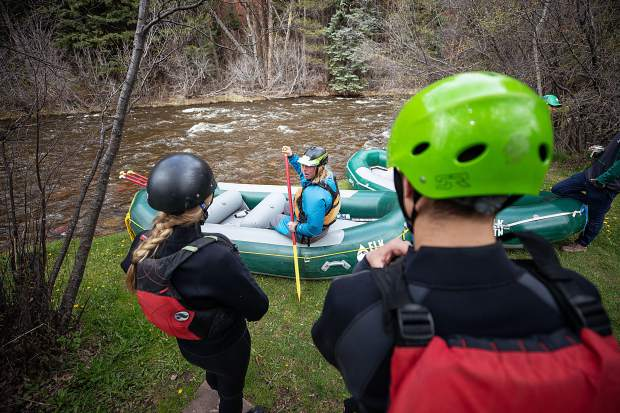 Elk Mountain Expeditions guide Curtis Berklund explains how to properly paddle before a Slaughterhouse Falls rafting trip on May 16.