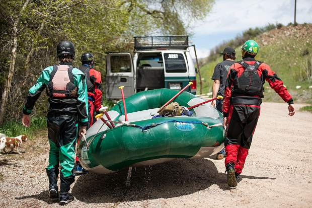 Elk Mountain Expeditions employees pack up a raft at Jaffee Park after running the Slaughterhouse section on the Roaring Fork River on May 16.