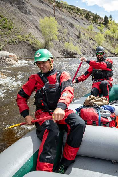 Elk Mountain Expeditions guide Tom Wills guiding on the Slaughterhouse falls section on the Roaring Fork River on May 16 with owner James Foerster.