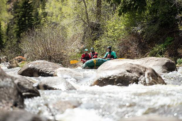 Elk Mountain Expeditions guide Tom Wills guiding on the Slaughterhouse falls section on the Roaring Fork River on May 16 with owner James Foerster, left, and guide Shaffer Klenda.