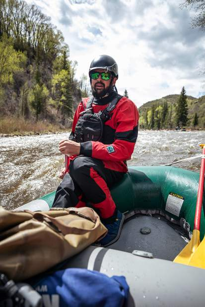 Elk Mountain Expeditions guide Tom Wills guiding on the Slaughterhouse falls section on the Roaring Fork River on May 16.