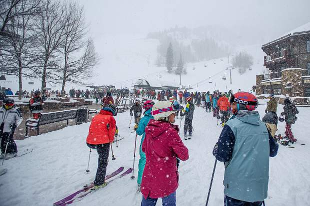 Skiers and snowboarders wait in line at the Exhibition lift at Aspen Highlands for opening day on Dec. 1, 2018.