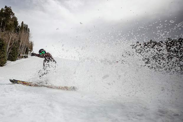 Kyle King slashes the slushy snow on Aspen Highlands in Aspen, CO on April 9, 2019.