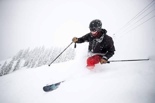 Travis Andrews skis through powder off of Temerity on Aspen Highlands on March 8.