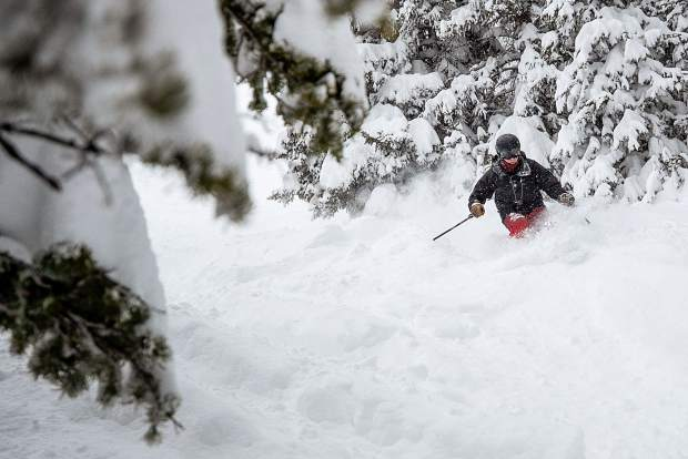 Travis Andrews skis through powder on Aspen Highlands on March 8.