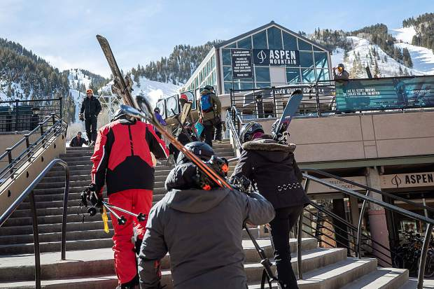 Skiers get ready to go up Ajax on Feb. 26, 2019.