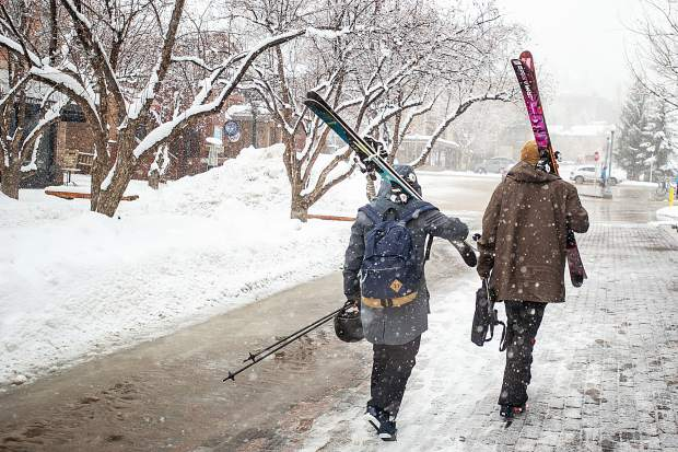 Argentinians Clementina Crozier, right, and Eugenia Poitevin walk through the snowy Aspen, Colorado pedestrian mall on Jan. 16, 2019, on their way to ski Aspen Mountain.