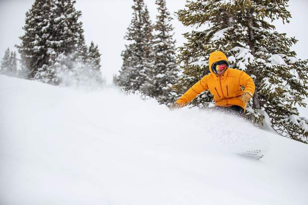Jon Barstow rides through powder on a run off of High Alpine at Snowmass Resort in Colorado on Mar. 7, 2019.
