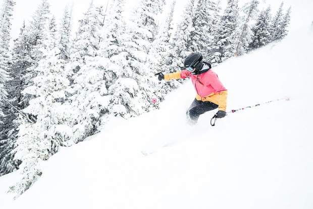 Alexa Falcone skis through powder on Walsh's on Aspen Mountain on April 11, 2019. 9 inches of fresh snow was reported.