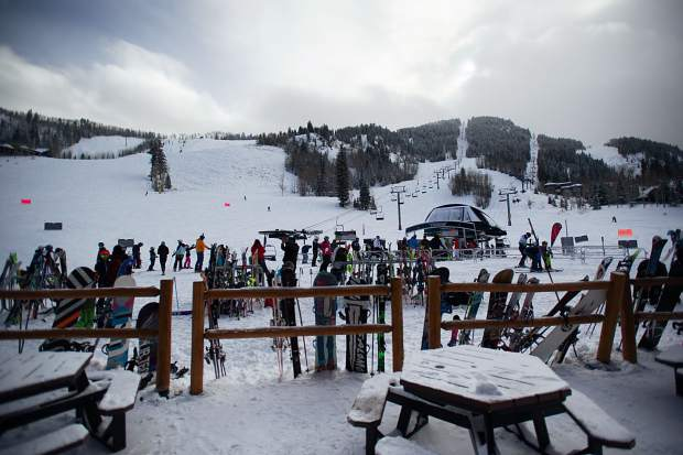 Skis and snowboards line the fence at the Aspen Highland's Ale House on Saturday for opening day Dec. 1, 2018.