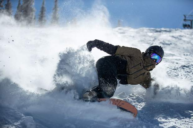 Alex Lorenz snowboards through fresh powder on Snowmass Mountain on Feb. 23.