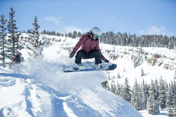 Michele Lohman gets air in the Cirque Dikes at Snowmass Mountain on Saturday. 5 inches of fresh snow was reported overnight. on Saturday. 5 inches of fresh snow was reported overnight.