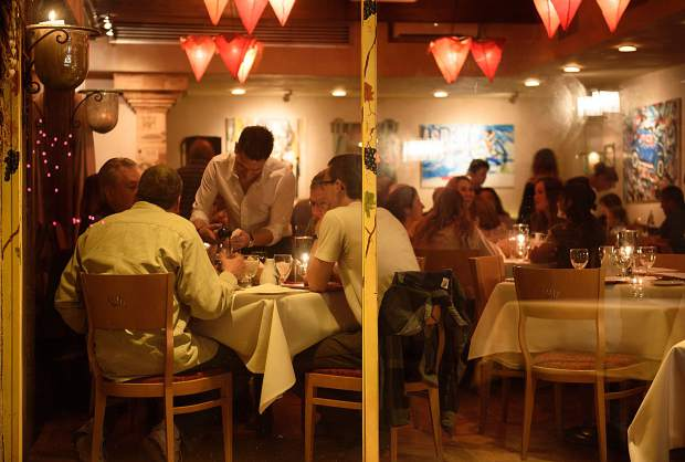 L'Hostaria's dining room has been cozy for 23 years.