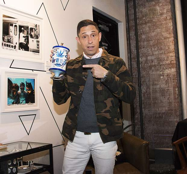 Jonathan Adler with one of his cannabis-inspired ceramic creations at the capsule collection launch party at Higher Standards in New York City earlier this month. Credit: Mike Lambert