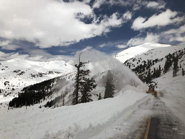 A Colorado Department of Transportation crew works on May 16 to clear a path to the summit of Independence Pass.