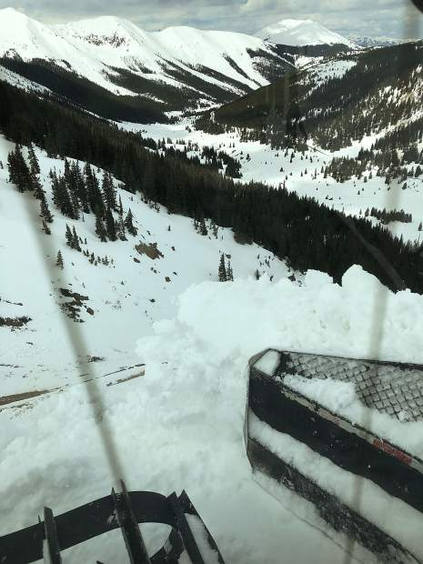 A CDOT Snowcat rides the edge of Highway 82 near the summit of Independence Pass on Thursday.
