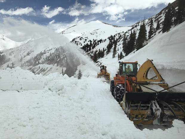 A Colorado Department of Transportation crew works May 16 to clear a path to the summit of Independence Pass from the Pitkin County side.