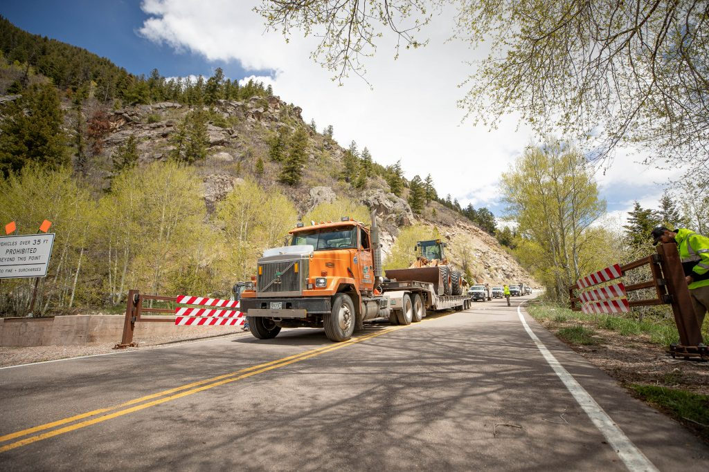 CDOT trucks drive through the Independence Pass gates Friday afternoon after opening for the season.