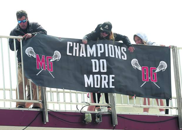 Prior to the Aspen High School boys lacrosse game against Telluride on Saturday, May 4, 2019, on the AHS turf, a banner was unveiled atop the press box in rememberance of lacrosse coaches Michael Goerne and Owen Green, who died in a February avalanche. (Photo by Austin Colbert/The Aspen Times).