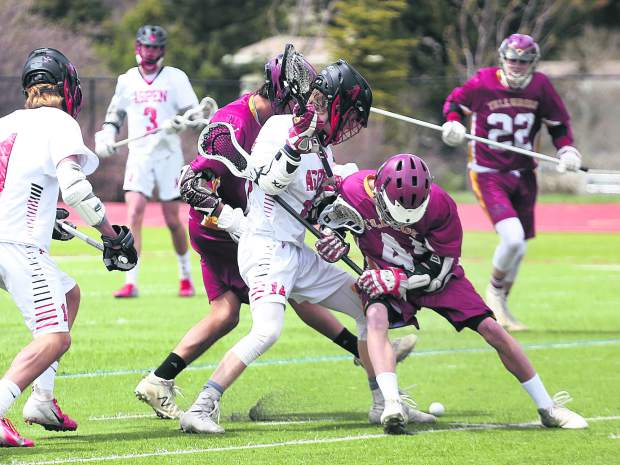 Players fight for the ball in the Aspen High School boys lacrosse team's game against Telluride on Saturday, May 4, 2019, on the AHS turf. (Photo by Austin Colbert/The Aspen Times).