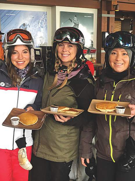 Emily Alexander, Taylor Comstock and Brittany Shami score powder pancakes on an 8