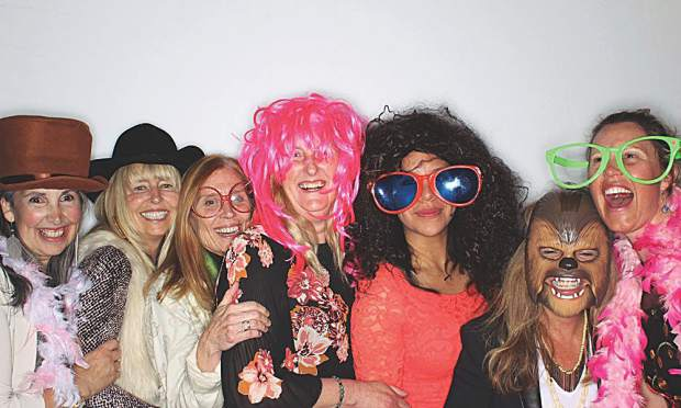 Teachers just want to have fun. Several of Wildwood's finest at the photobooth.