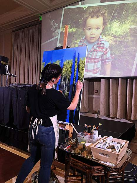 Artist Isabella Garraffa generously gave her time and talent in creating a painting during the gala event that was then sold in the live auction.