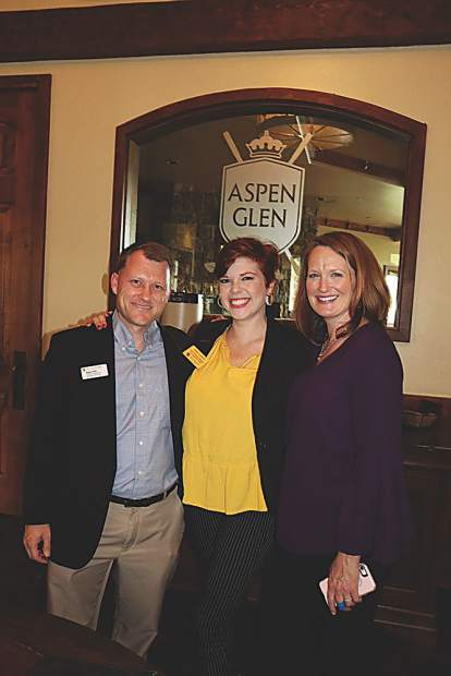CU staff Ryan Huff, Hailee Koehler and Sarah Adderholt welcome guests to Aspen Glen for the CU event.